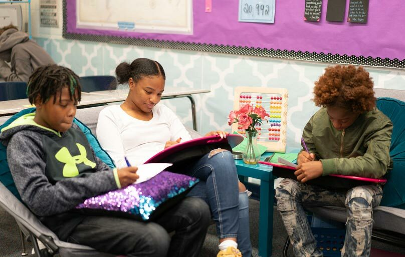 Our classrooms offer alternative seating for students to work comfortably as they work