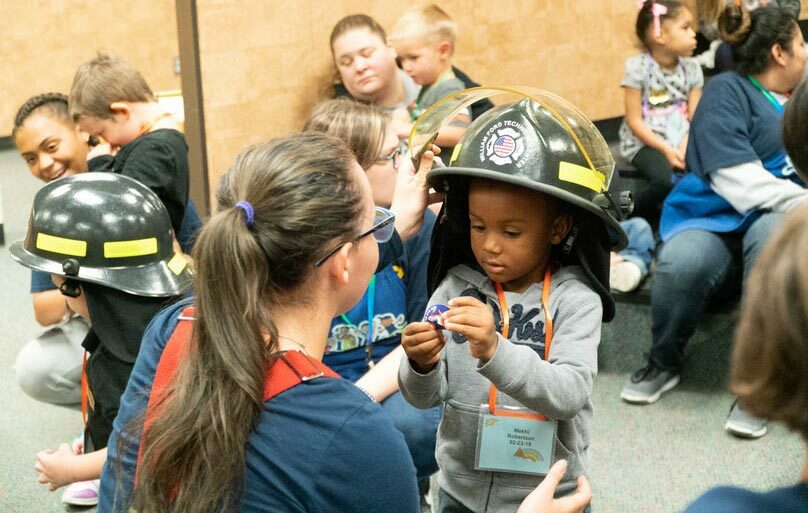 Every year our Firefighter & EMT classes demonstrate fire safety and how to call 911 to our preschool Sunshine & Rainbow program