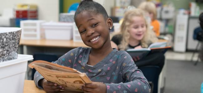 Student happily reading 3