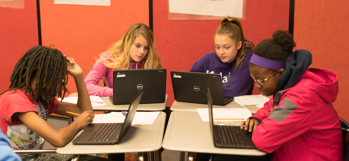 Students workng on a group project with Chromebooks at Stevenson