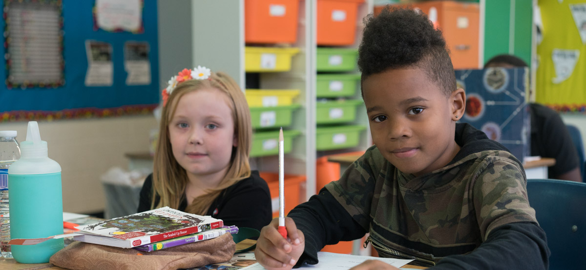 Two students studying in class 4