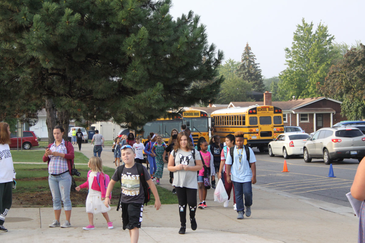 students heading to school for their first day of class at MUE